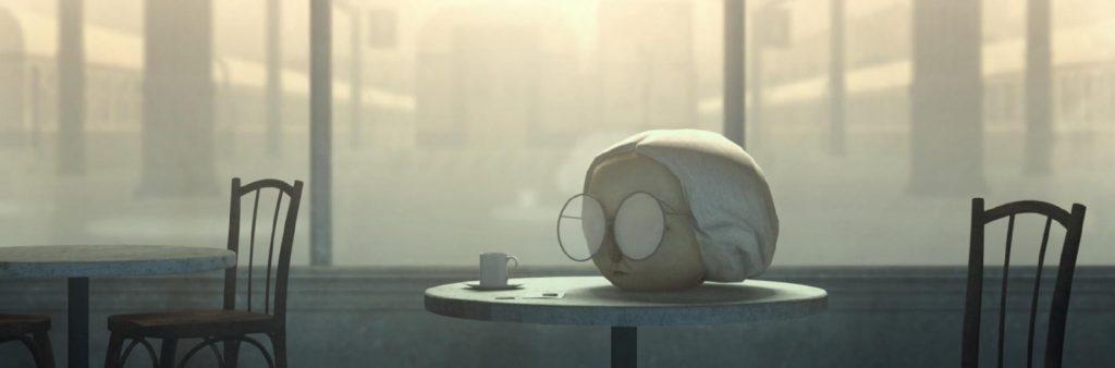 Une tête posée sur une table dans Une tête disparaît